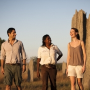 Tess Atie with couple at termite mounds